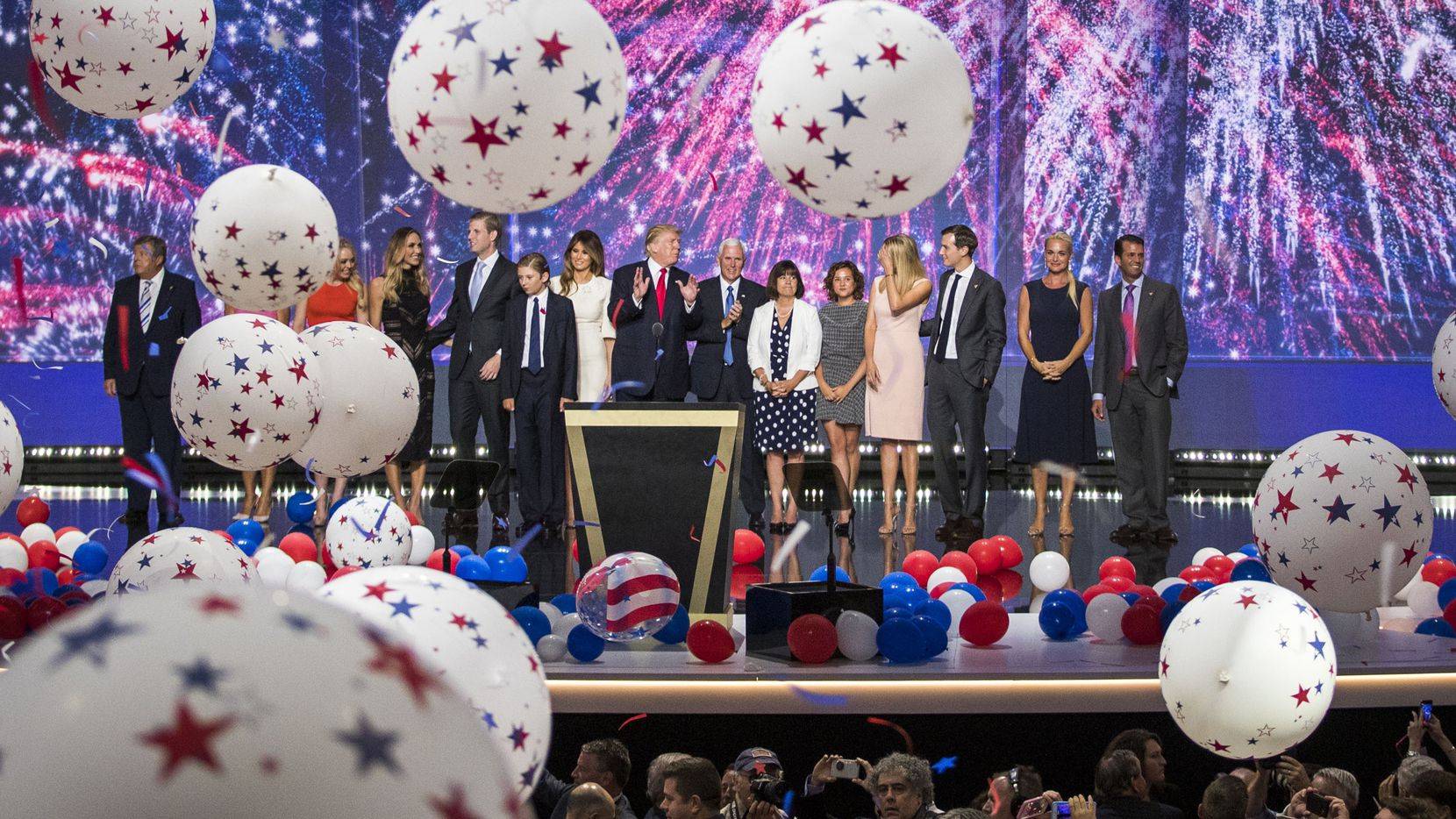 Donald Trump and  Mike Pence celebrate with their families as balloons drop on the final night of the Republican National Convention on July 21, 2016, in Cleveland.