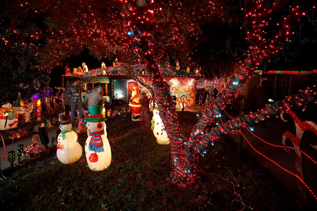 """People tour the lights at the home of Liz Simmons, at 714 Newell Ave in Dallas on Dec. 16, 2018.  The extravagant Christmas display, called """"Electric Lizzy Land"""" will be on display through the end of the year.(Michael Ainsworth/Special Contributor)"""