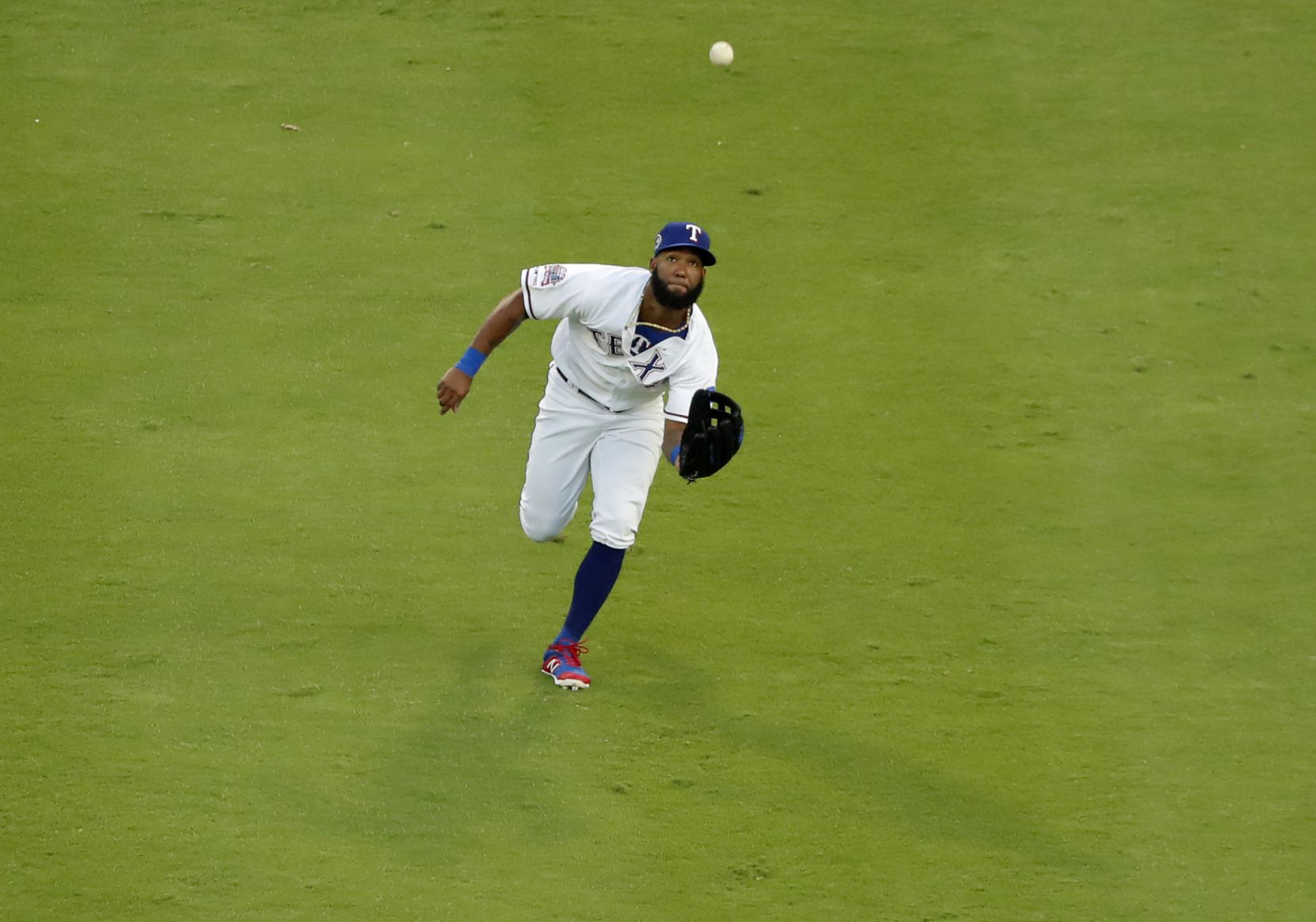 Texas Rangers center fielder Danny Santana reaches out to field a fly out by Tampa Bay Rays' Austin Meadows in the first inning of a baseball game in Arlington, Texas, Wednesday, Sept. 11, 2019. (AP Photo/Tony Gutierrez)