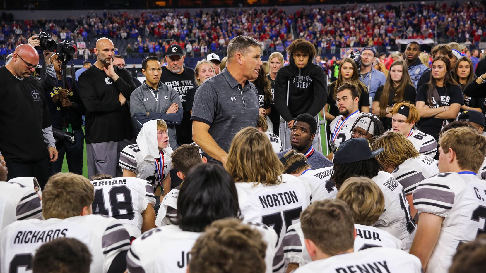Denton Guyer's coach John Walsh talks to his team after losing a Class 6A Division II state championship game against Austin Westlake at the AT&T Stadium in Arlington, on Saturday, December 21, 2019. Westlake won the game 24-0. (Juan Figueroa/The Dallas Morning News)