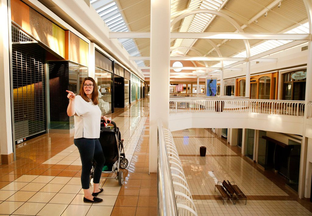 Pushing her two young sons in a stroller in an empty Collin Creek Mall, Plano resident Molly Blonn reminisced Wednesday about the days when she hung out at the shopping center, then later worked at the mall's Disney Store.