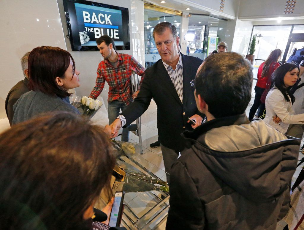 Dallas Mayor Mike Rawlings greets detainees from Iran and their families after a media briefing in North Dallas on Sunday, January 29, 2017.