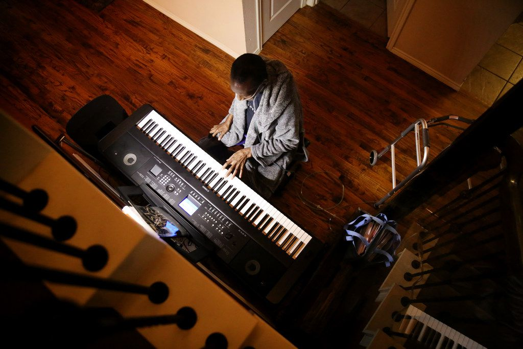 Johnnie Lindsey plays the keyboard at his home in Dallas.
