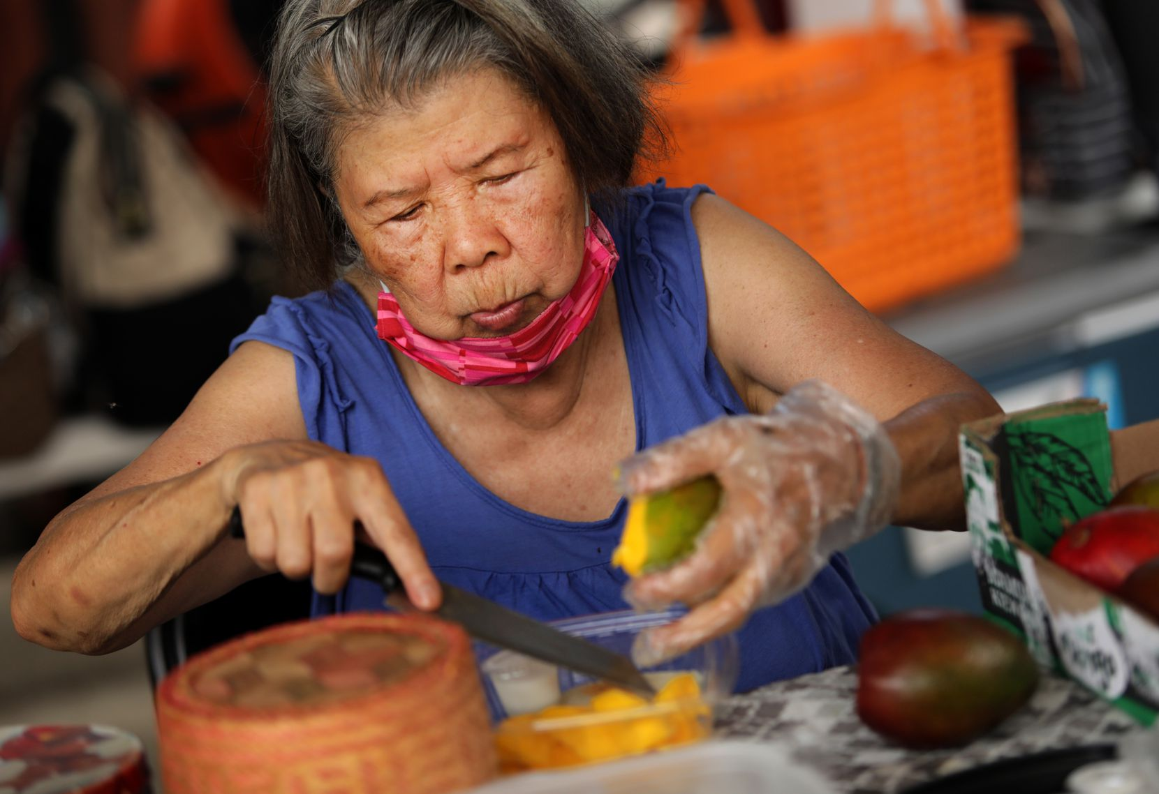 Wanna Chen prepares sweet sticky rice with mango during the Sunday Thai Food Market.