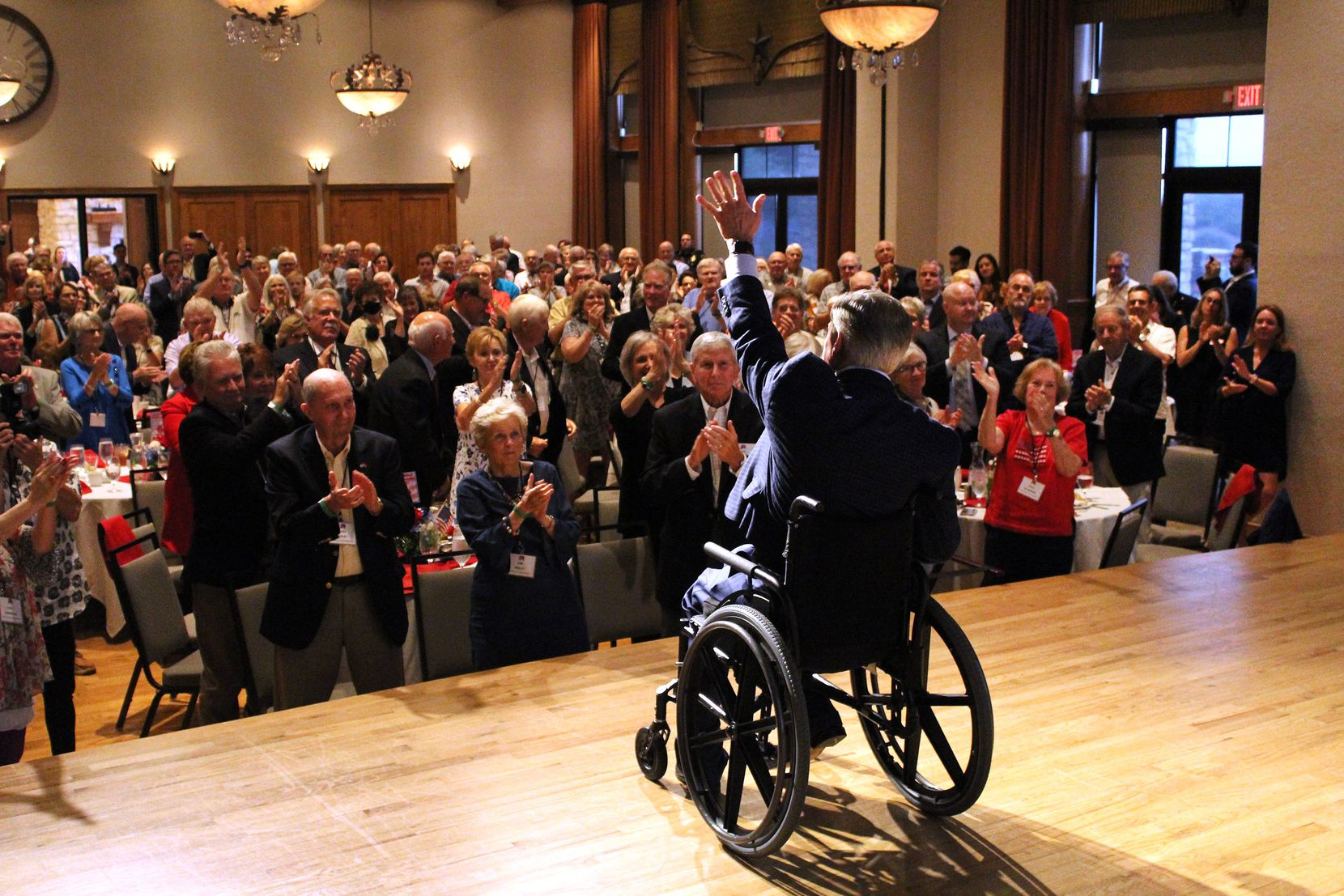 """Gov. Greg Abbott, who is up for re-election next year, tweeted this photo of himself at a Collin County Republican group on Aug. 17, shortly before he tested positive for COVID-19. """"Let's keep this energy up and send a message that Texas values are NOT up for grabs in 2022,"""" he wrote in the tweet."""