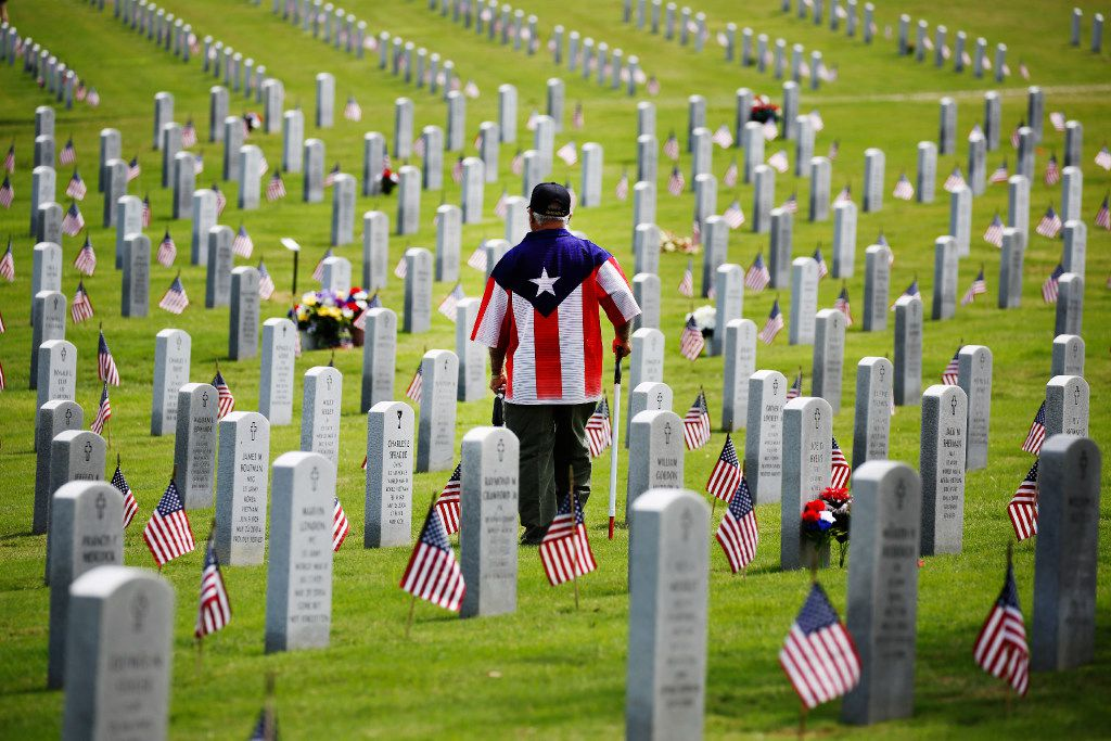 Johnny Torres, 65, served thirteen years in the Army, looks for the headstone of his great uncle after the DFW National Cemetery Memorial Day celebration at the Dallas-Fort Worth National Cemetery in Dallas on  May 29, 2017.