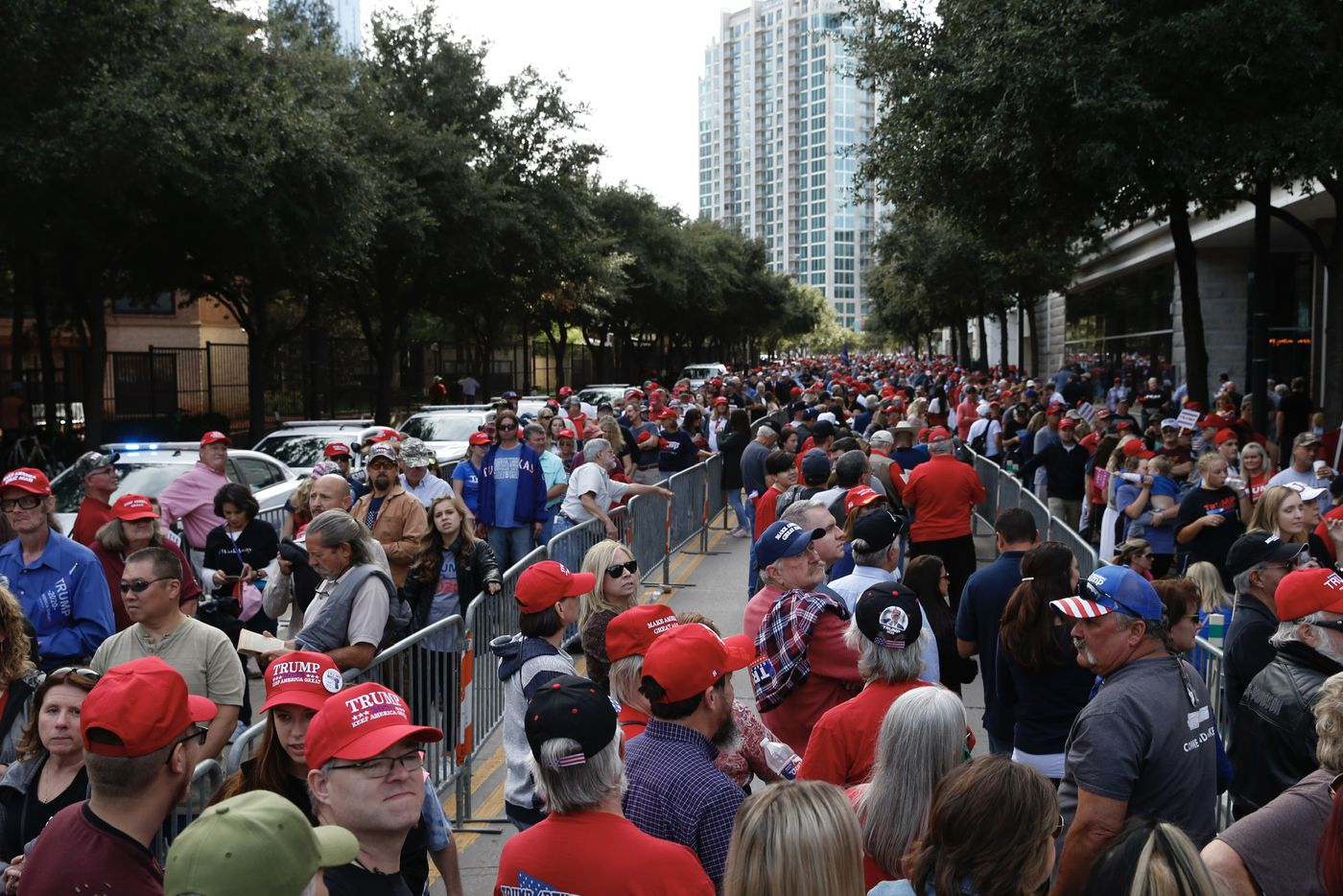 People wait in line to enter the Keep America Great Rally for President Donald Trump at the American Airlines Center in Dallas, on Thursday, October 17, 2019.