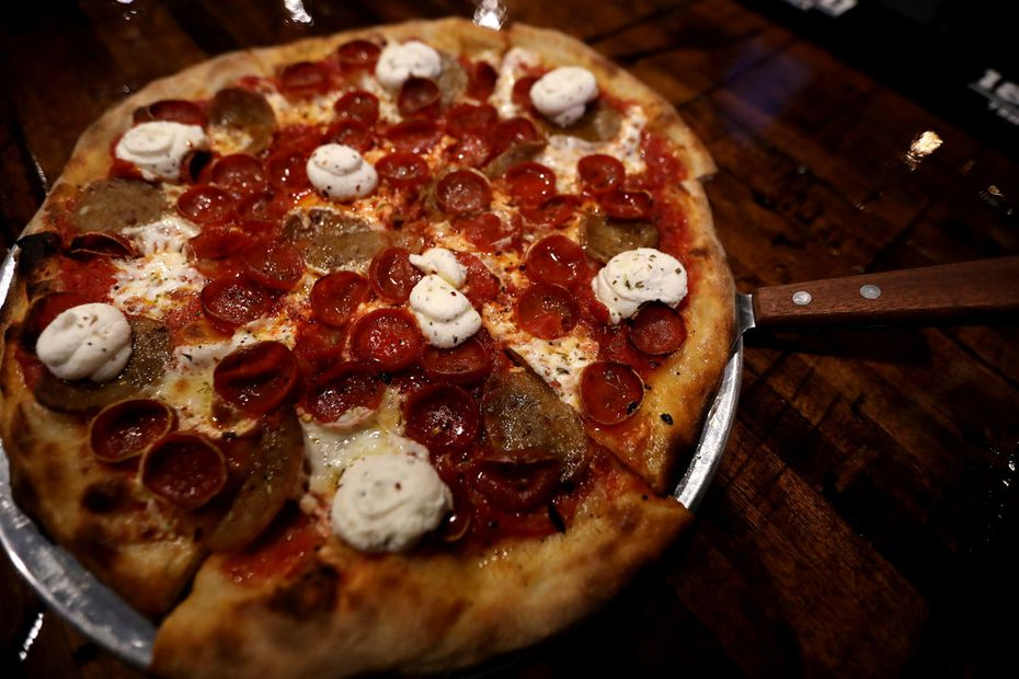 The Big Apple Pizza at Rotolo's Craft & Crust in Frisco comes with crushed tomato sauce, mozzarella, sliced Italian sausage, and ricotta.