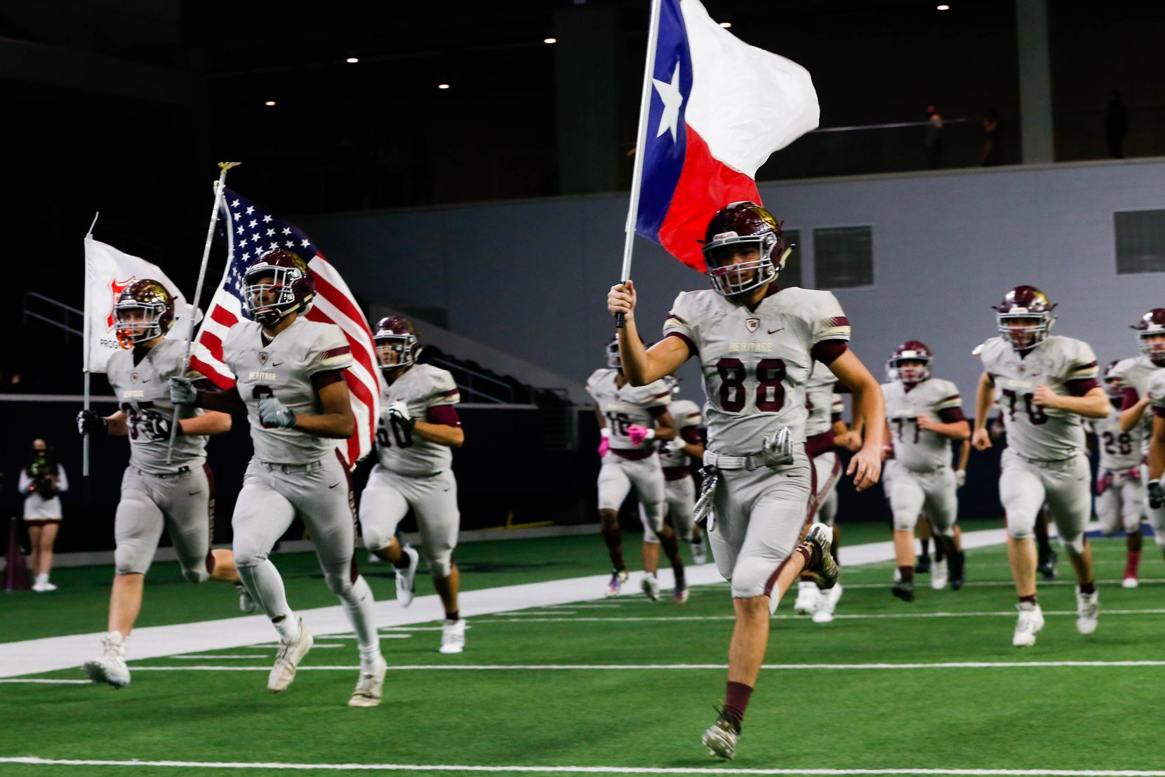 Frisco Heritage football players run out before the start of a game against Frisco Independence at the Ford Center at the Star in Frisco on Thursday, Dec. 3, 2020. (Juan Figueroa/ The Dallas Morning News)