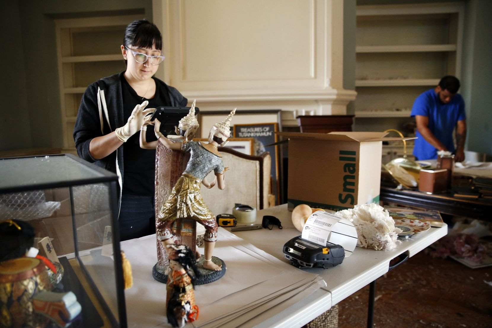Nina Klaser (left) of Art of Dallas-Fort Worth, an art recovery and restoration company, catalogues Brenda Schneider's family heirlooms and art collectibles in her Preston Hollow neighborhood home in Dallas, Tuesday, Oct. 22, 2019.