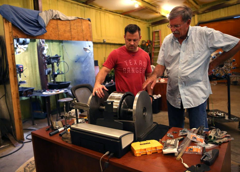 Brad Hunstable (left) and his father, Fred, go over the fine points of one of the their electric motor prototypes. Their company, Linear Labs, began as a father-son project to increase the efficiency of electric motors that could be used in automobiles, ceiling fans or drones.