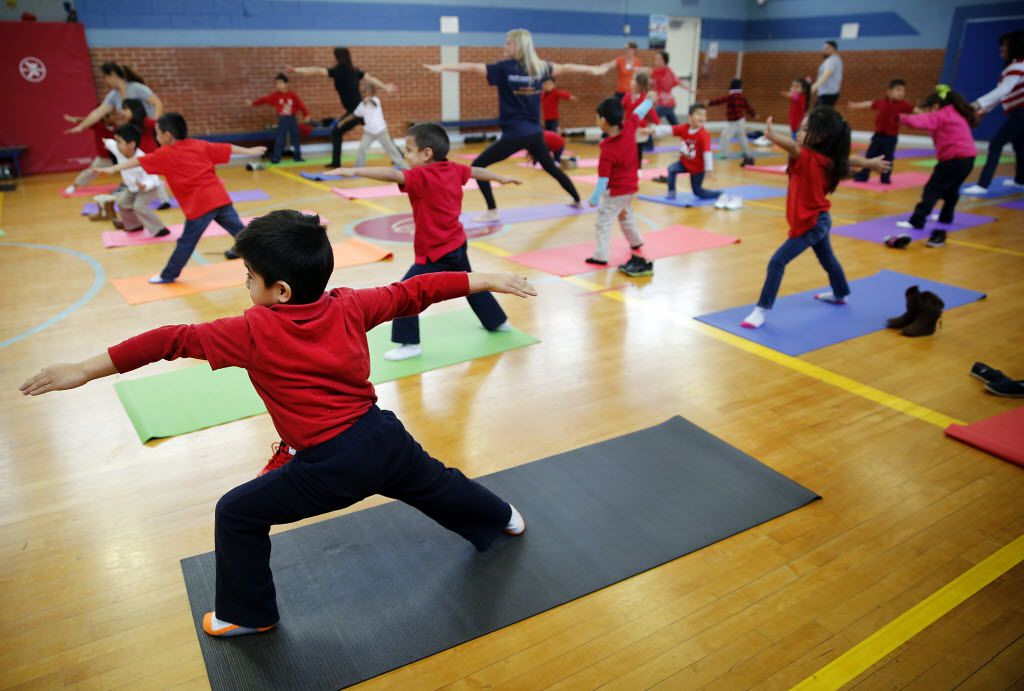 Brandon Pastor (front) participated with approximately 50 prekindergarten students in Yoga Recess Day at Robert E. Lee Elementary School in Dallas in February 2015. (Tom Fox/The Dallas Morning News)