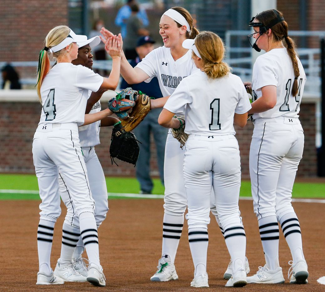 Denton Guyer's Kate Moala (17) celebrates with teammates during the third inning of a nondistrict softball game in Denton on Tuesday, March 30, 2021. (Juan Figueroa/ The Dallas Morning News)