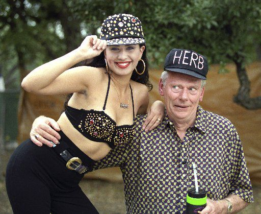 Southwest Airlines' chairman Herb Kelleher mugs  the camera with Sabrina Gonzales, a Southwest Airlines receptionist  at their chili cook-off in San Antonio in 1991.
