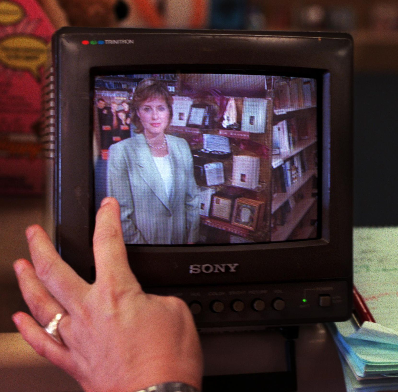 Peggy Wehmeyer is pictured on a monitor while her producer critiques a segment for Good Morning America about the book The Prayer of Jabez  in May 2001 at a Garland bookstore.