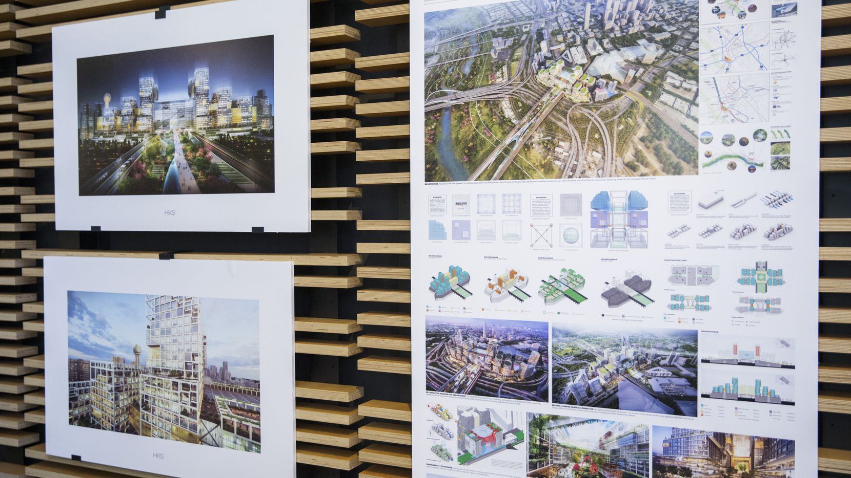 Artist renderings of pitches for Amazon's possible Dallas HQ2 location were displayed during an Urban Land Institute panel discussion in 2019 at HKS in downtown Dallas. (Ashley Landis/The Dallas Morning News)