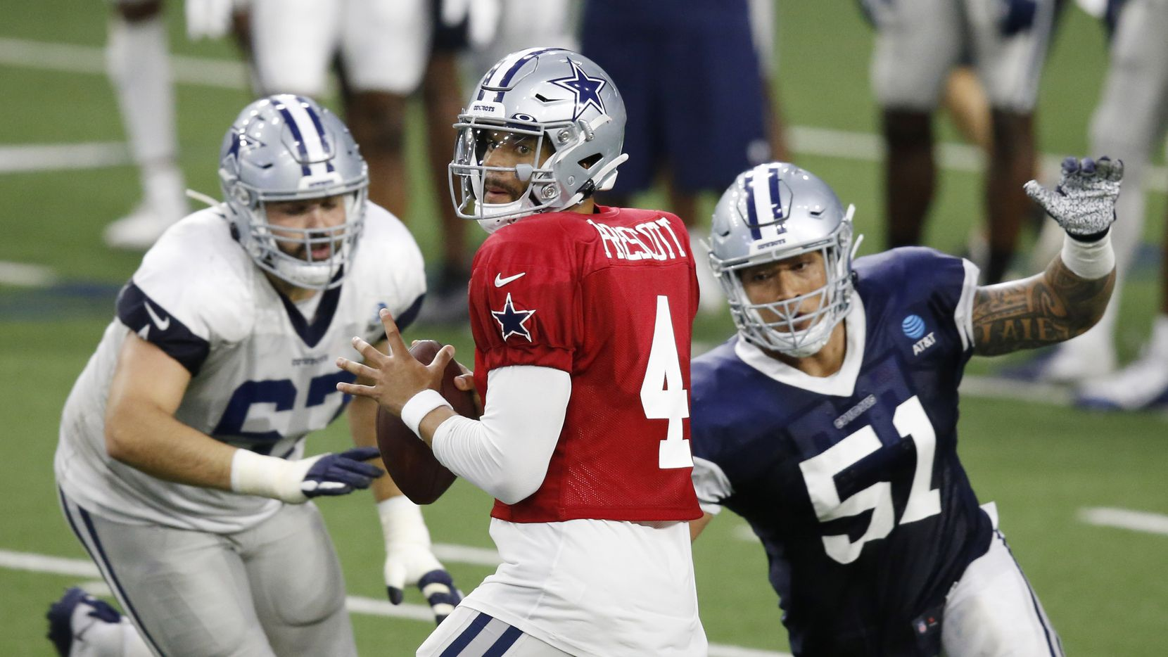 Dallas Cowboys quarterback Dak Prescott (4) looks to pass as Dallas Cowboys defensive end Bradlee Anae (51) closes in on him during training camp at the Dallas Cowboys headquarters at The Star in Frisco, Texas on Thursday, August 27, 2020.