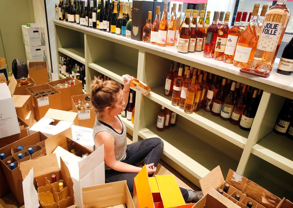 Beverage director and Sommelier Christina Chilcoat rearranges bottles of wine at the soon-to-open Royal Blue Grocery at Main and Ervay streets in downtown Dallas, Friday, July 27, 2018. (Tom Fox/The Dallas Morning News)
