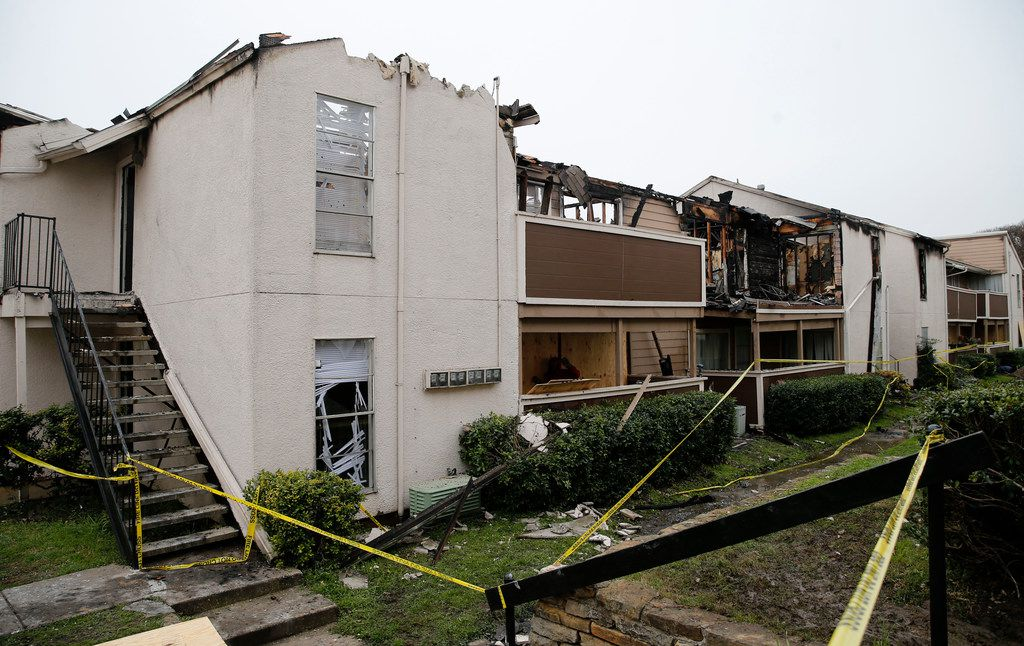 Damage is evident after an apartment fire damaged eight units at Del Rey Village Apartments in Dallas on Friday, March 1, 2019.