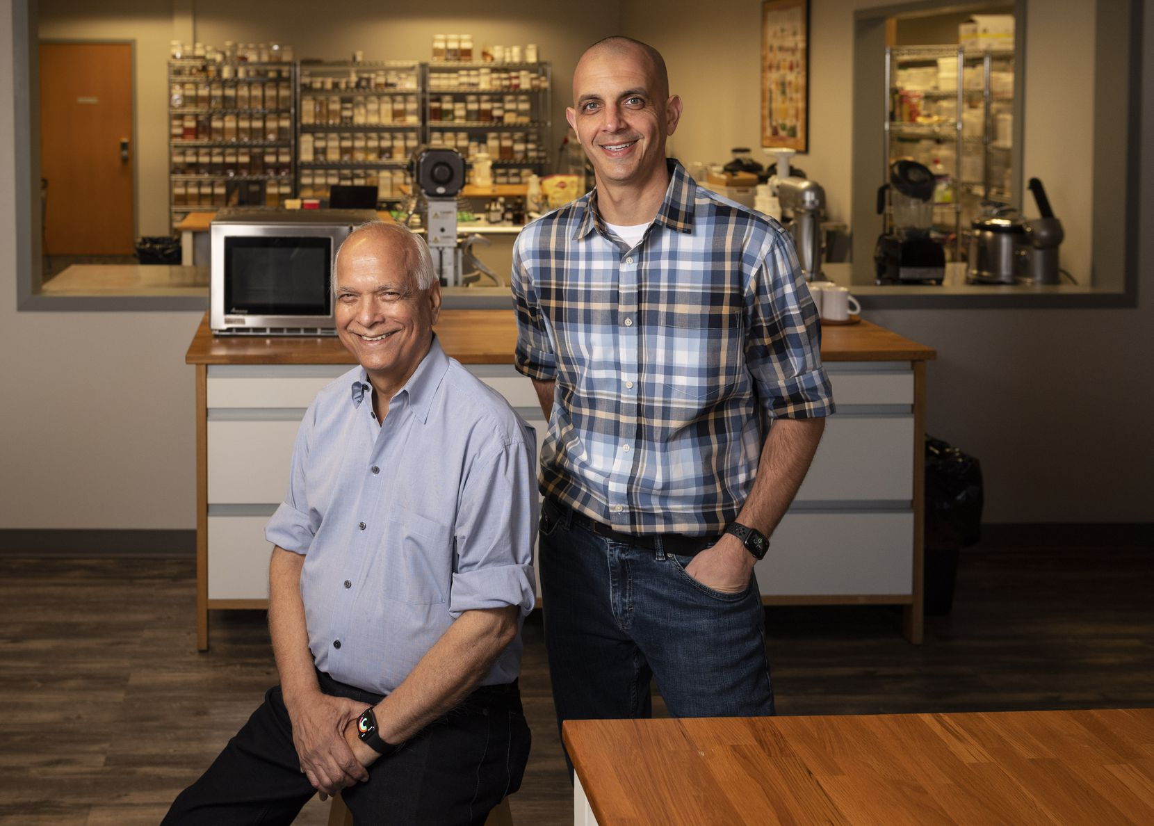 Surinder Kumar, left, CEO-Chief Innovation Officer, and his son Daven Kumar, Co-founder and CMO of TruEats Modern Baking Company, inside a research and development lab at Culinary Focus in Grand Prairie
