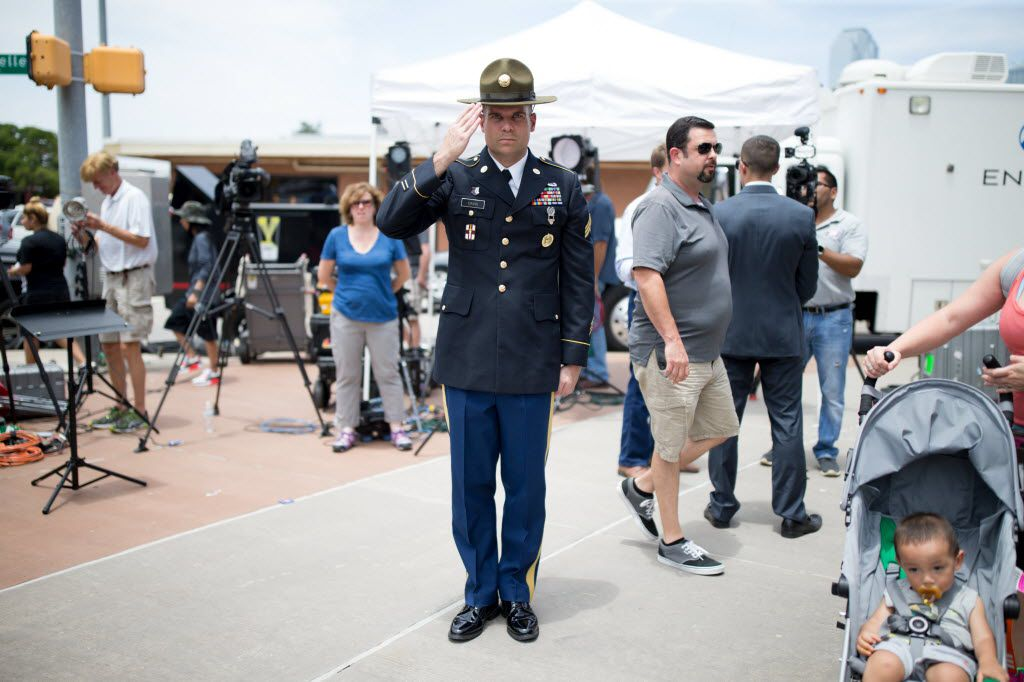 Retired Army combat medic Chandler Davis stood saluting the memorial for the slain officers at Dallas police headquarters on July 9, 2016, two days after the downtown ambush. (File Photo/Staff)