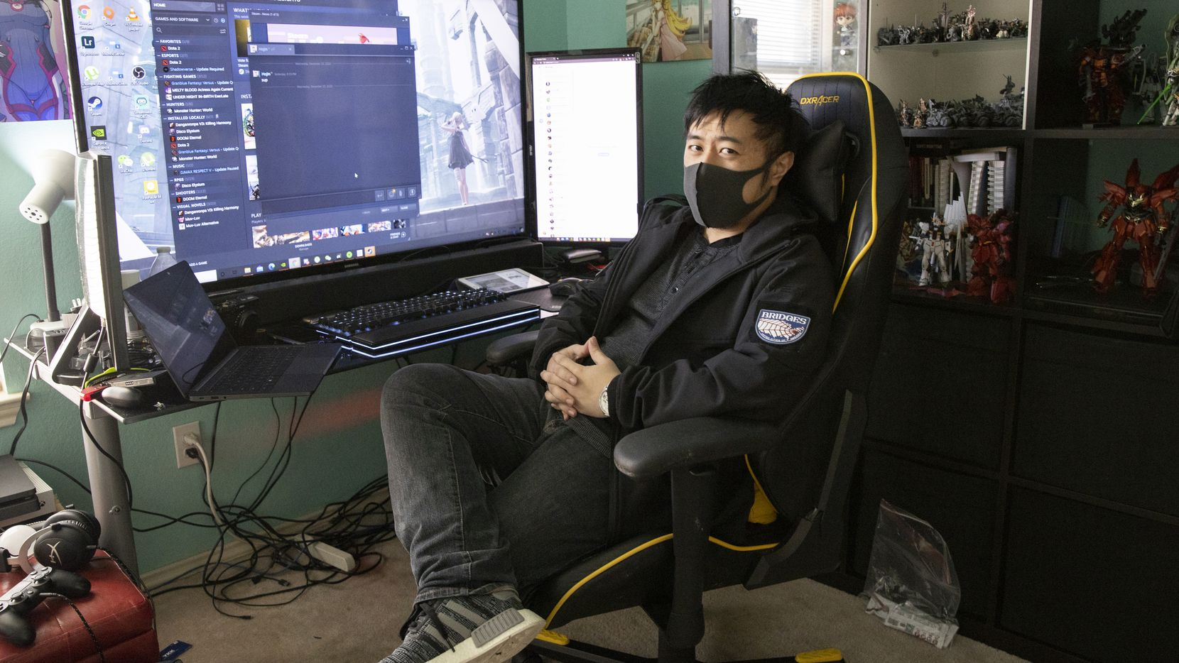 Warren Lee poses in his home office in Euless after returning from Wuhan on Thursday, Dec. 24, 2020. After nearly 11 months overseas, Lee returned home this week.