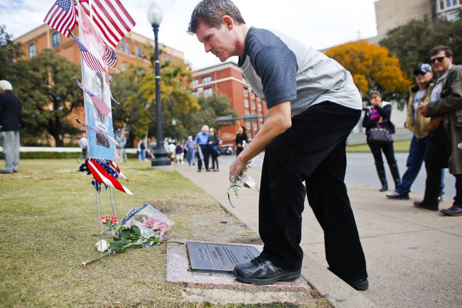 Wayne Adam of Toronto, Canada, in town on business, paid his respects Thursday in downtown Dallas on the 49th anniversary of the JFK assassination.