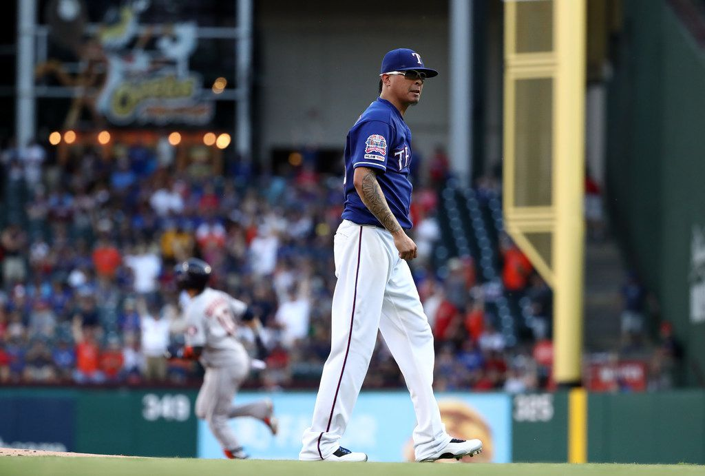 ARLINGTON, TEXAS - JULY 12:  Jesse Chavez #53 of the Texas Rangers steps off the mound after giving up a two-run homerun against Yuli Gurriel #10 of the Houston Astros in the second inning at Globe Life Park in Arlington on July 12, 2019 in Arlington, Texas. (Photo by Ronald Martinez/Getty Images)