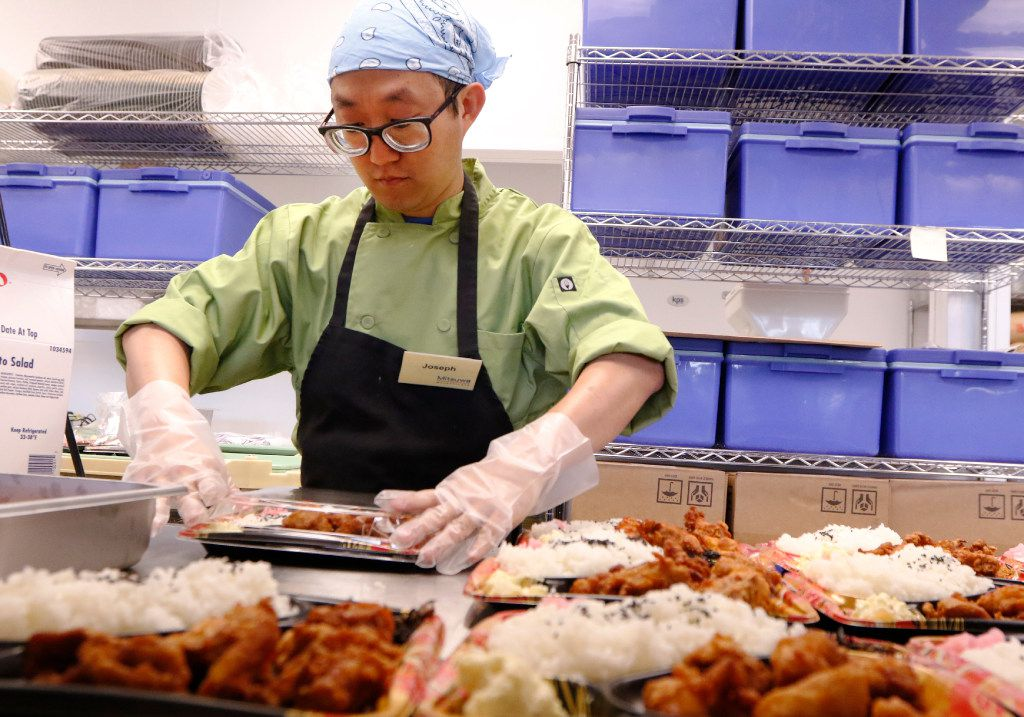 Joseph Lee prepares Japanese food at Mitsuwa Marketplace on Thursday, April 13, 2017. The grand opening will be on Friday, April 14, 2017 in Plano. It carries a wide variety of quality Japanese groceries, general items, electric appliances, cosmetics and other products in its stores. They were established in March 1998 and currently have nine stores across the United States: seven in California, one in New Jersey, and one in Chicago. Photo taken on Thursday, April 13, 2017.