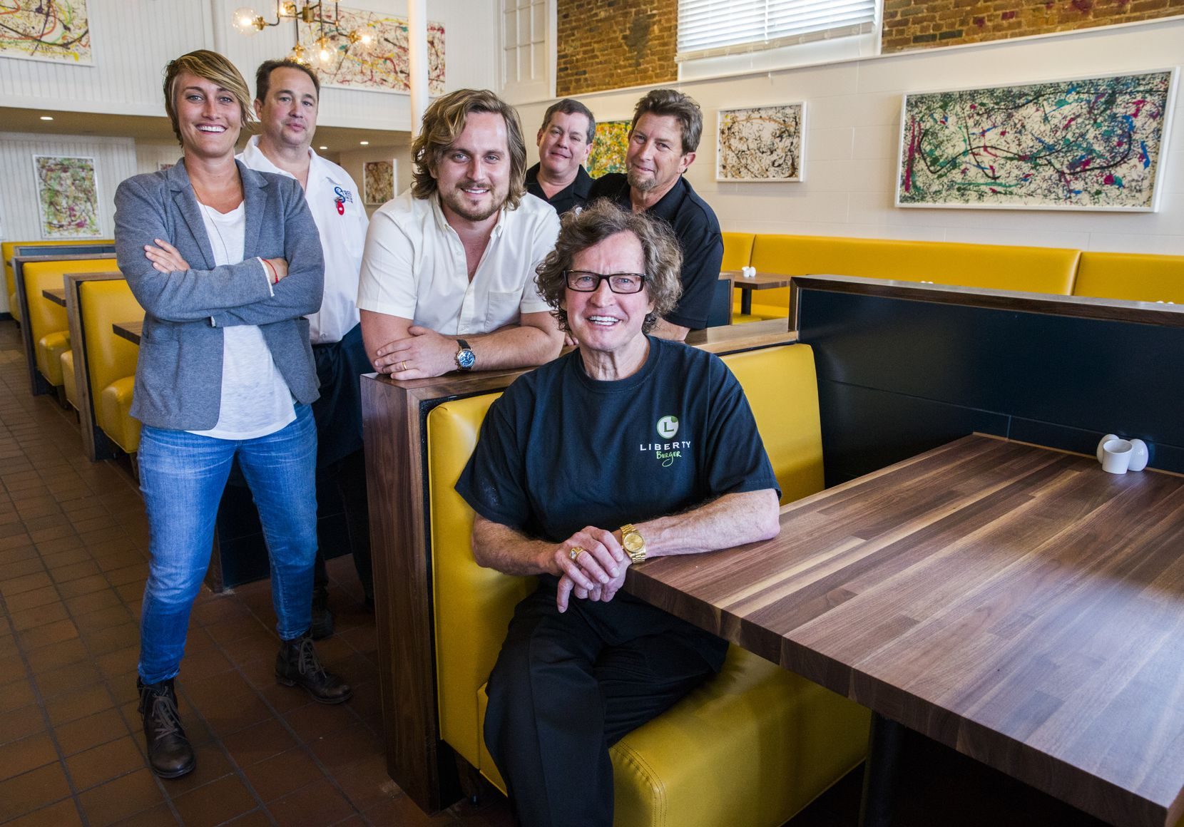 Gene Street (front), cofounder of the Black Eyed Pea restaurants, poses for a photo with (from left) his daughter Mariel Street, nephew Tony Street, son Marco Street, son Dace Street and son Gene Street Jr., in their new restaurant, Street's Fine Chicken, on Friday, May 6, 2016 on Cedar Springs in Dallas. (Ashley Landis/The Dallas Morning News)