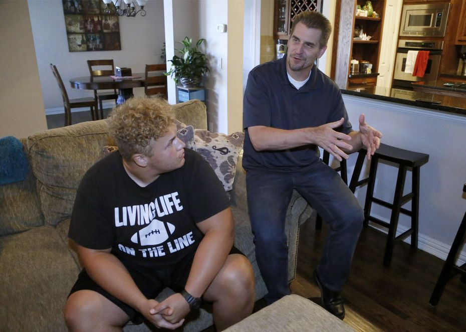 Izeya Floyd, a senior at Reedy High School, talks about his high school experience in the Frisco School District with his father Brett (right) from the living room of his home in Frisco on Thursday, August 2, 20018. (Stewart F. House/Special Contributor)