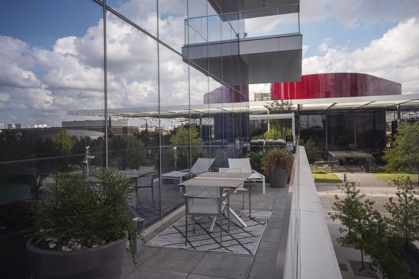 Terrace space with a view of the Winspear Opera House at the Hall Arts Residences.