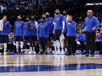The Dallas Mavericks watch during the fourth quarter of their home opener against the Houston Rockets on Tuesday, Oct. 26, 2021, at the America Airlines Center in Dallas. The Dallas Mavericks won, 116-106.