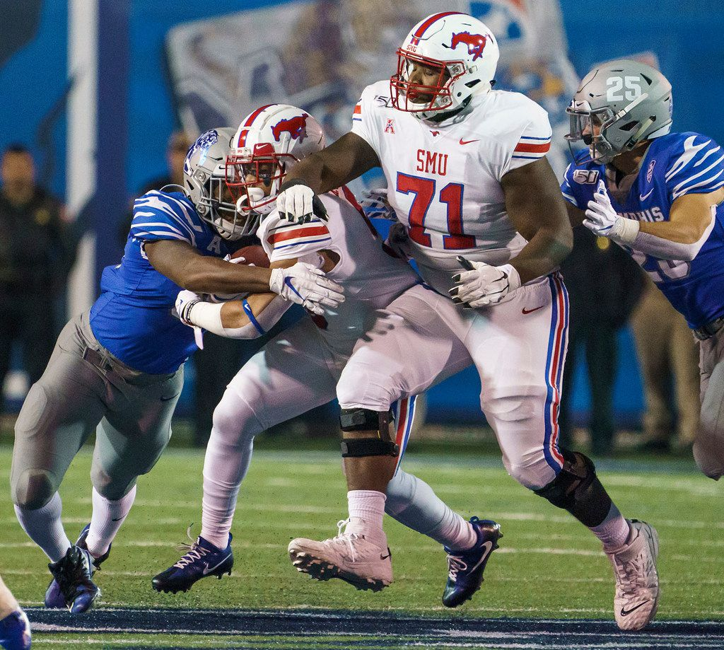 SMU running back Xavier Jones (5) is brought down by Memphis linebacker Tim Hart (35) as SMU offensive lineman Jaylon Thomas (71) tries to block against Memphis linebacker Austin Hall (25) during the first half of an NCAA football game at Liberty Bowl Memorial Stadium on Saturday, Nov. 2, 2019, in Memphis, Tenn. (Smiley N. Pool/The Dallas Morning News)