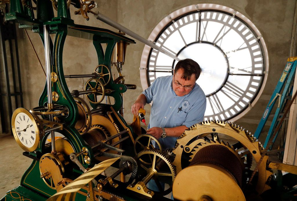Historic clock restoration specialist Chuck Roeser Right) of Lockport, New York lubricates the E. Howard & Co. bell tower clock in the old, red Dallas County Courthouse, now known as Old Red Museum, in downtown Dallas, Saturday, March 9, 2019. Roeser makes a pair of trips every year to adjust, clean and set the daylights savings time, which begins early Sunday morning.
