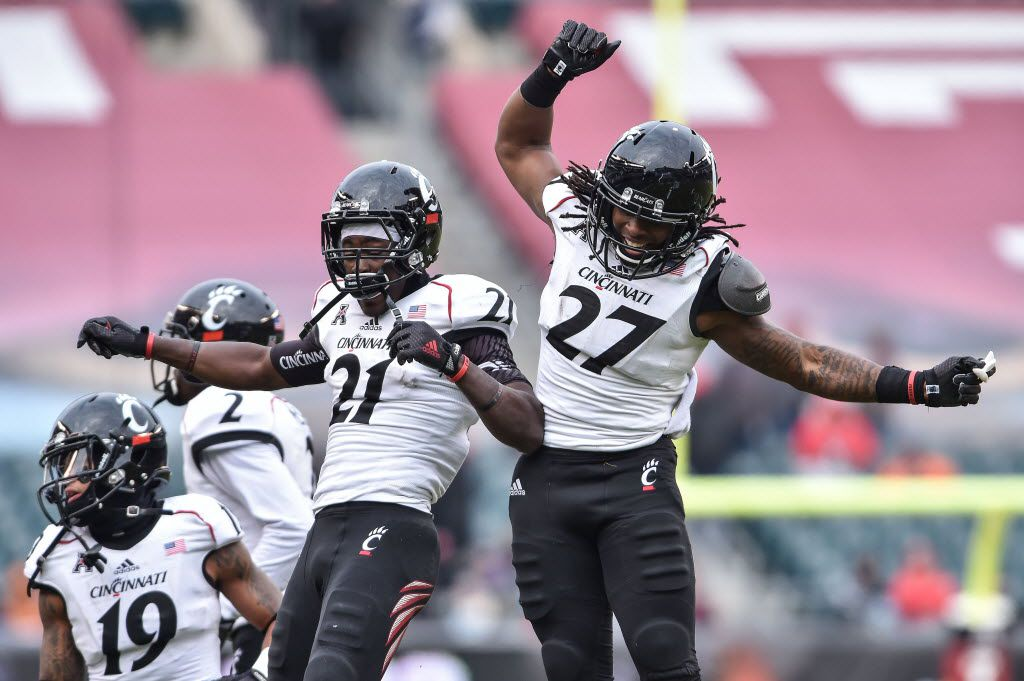Nov 29, 2014; Philadelphia, PA, USA; Cincinnati Bearcats running back Mike Boone (27) celebrates his touchdown with Bearcats running back Rodriguez Moore (21) during the second quarter against the Temple Owls at Lincoln Financial Field. Mandatory Credit: John Geliebter-USA TODAY Sports 12142014xSPORTS