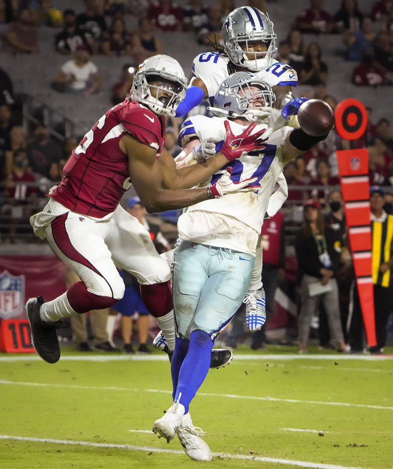 Dallas Cowboys linebacker Luke Gifford (57) and safety Steven Parker (25) break up a pass intended for Arizona Cardinals tight end Demetrius Harris (86) during the second half of a preseason NFL football game at State Farm Stadium on Friday, Aug. 13, 2021, in Glendale, Ariz.