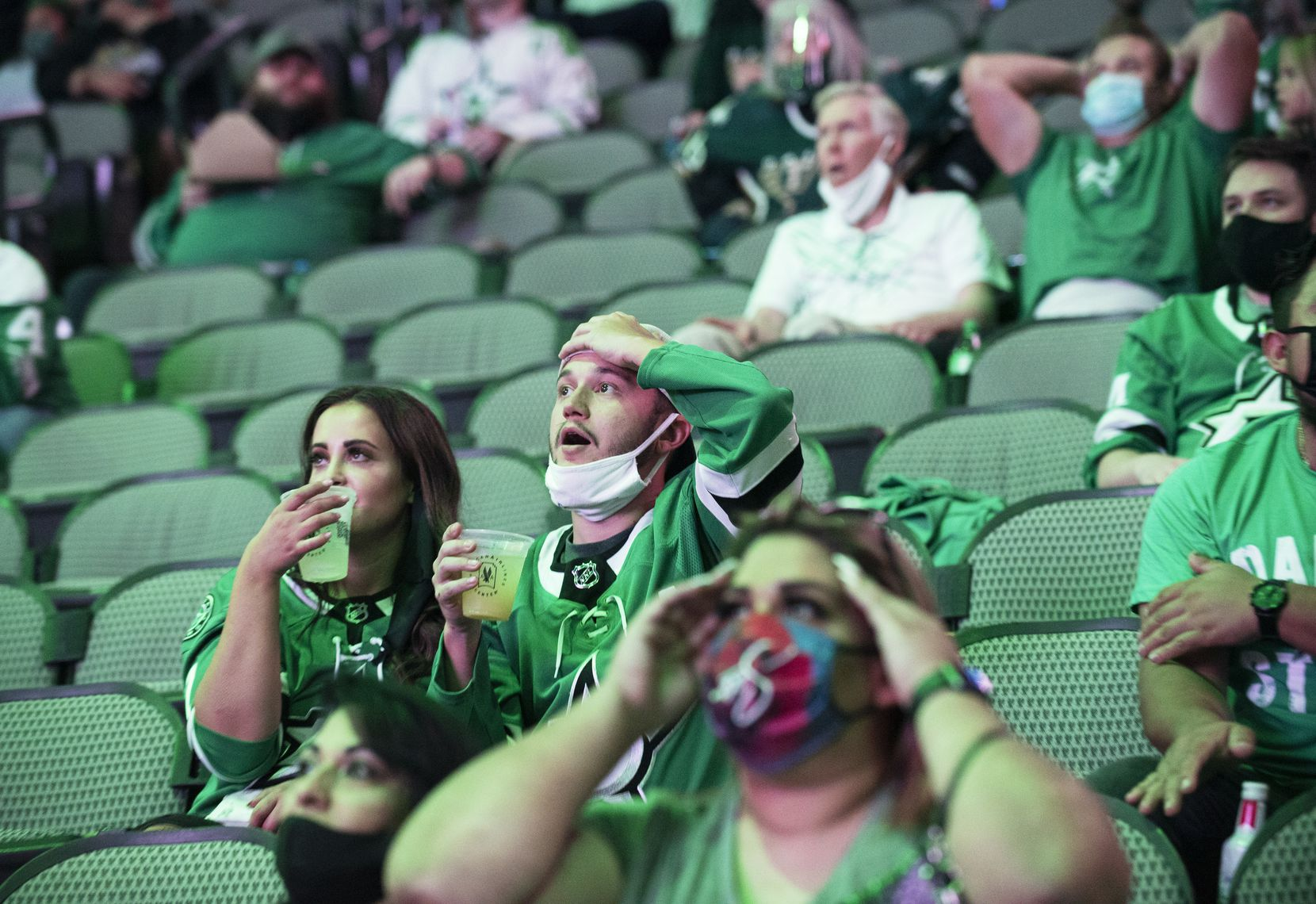 Fans react with disbelief while watching the Tampa Bay Lightning versus the Dallas Stars during a watch party at the American Airlines Center for game 1 of the Stanley Cup Final, Saturday, on Sept. 19, 2020. Ben Torres/Special Contributor