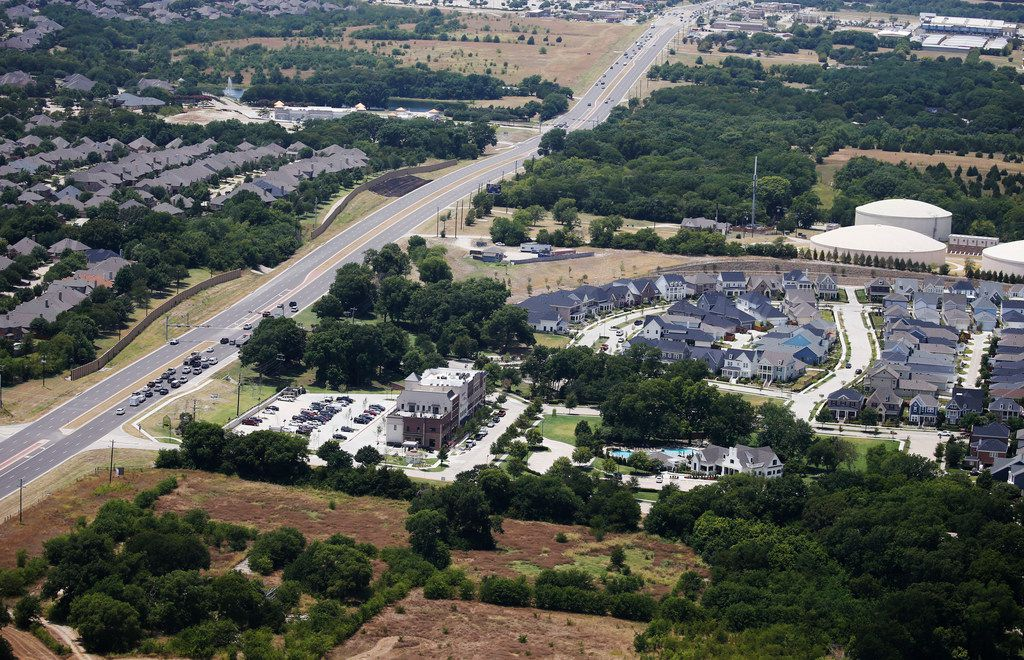 Tucker Hill neighborhood sits up against U.S. 380 in McKinney on July 20. (Vernon Bryant/The Dallas Morning News)