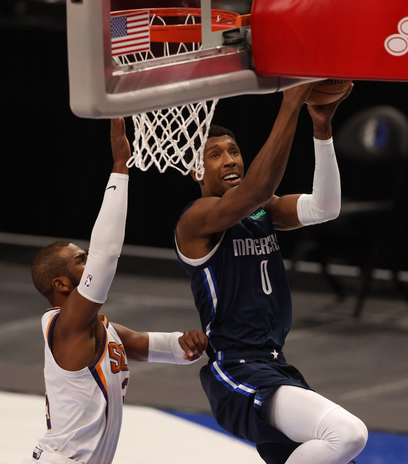 Dallas Mavericks guard Josh Richardson (0) attempts a layup in front of Phoenix Suns guard Chris Paul (3) during the first quarter of play at American Airlines Center on Monday, February 1, 2021in Dallas. (Vernon Bryant/The Dallas Morning News)