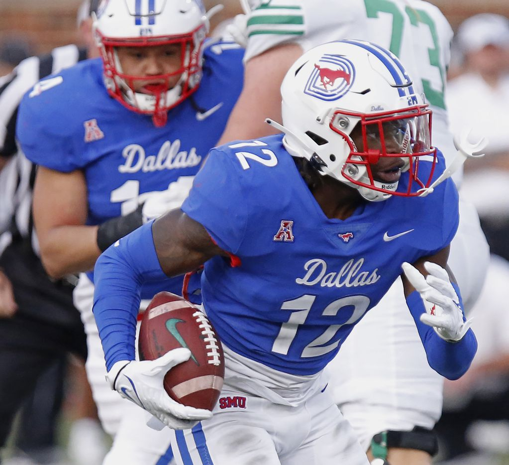 Southern Methodist Mustangs safety Isaiah Nwokobia (12) runs after an interception during the first half as SMU hosted UNT at Ford Stadium in Dallas on Saturday, September 11, 2021.