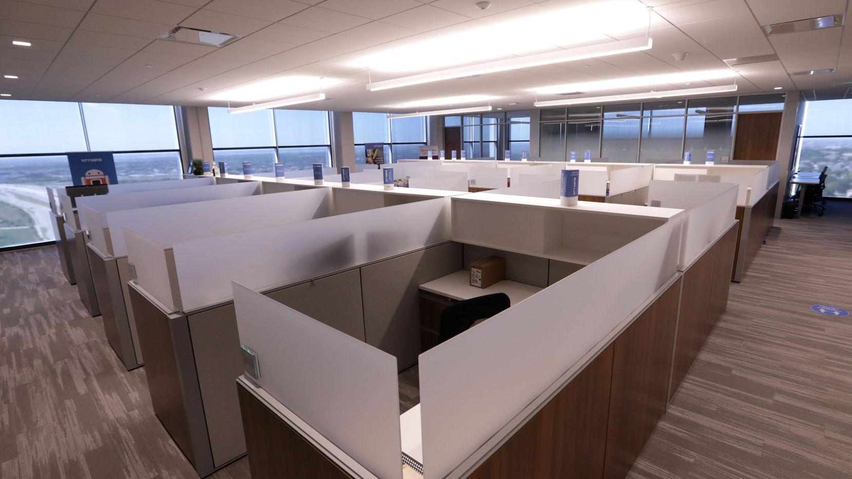 """The offices of NTT Data Services in Plano have been mostly empty during the pandemic, and when they reopen, employees can elect to come into the office or work at home. """"We're really focused on empowering the worker in those situations,"""" said Eric Clark, chief digital and strategy officer."""