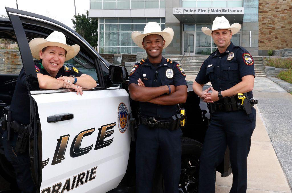 Grand Prairie police officers Sgt. Brandy Elliott (from left), Louis Johnson and Mark Beseda sport their new cowboy hatsat the Grand Prairie police headquarters.