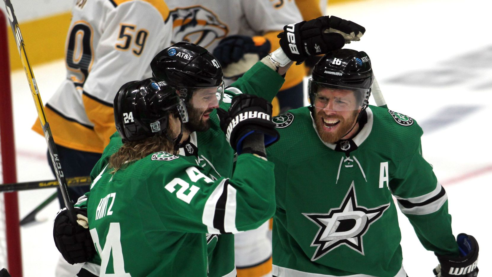 Dallas Stars forward Roope Hintz (24) ,left, set off a celebration with teammates Alexander Radulov (47), center, and Joe Pavelski (16) after Hintz scored on an assist from Pavelski during 2nd period action against the Nashville Predators. The two teams played their NHL game at the American Airlines Center in Dallas on January 24 , 2021.
