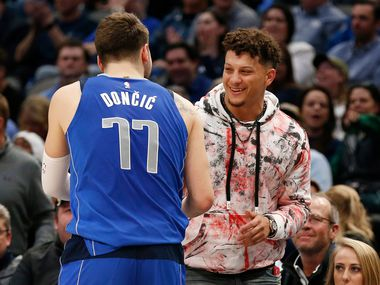 Dallas Mavericks guard Luka Doncic (77) greets Kansas City Chiefs Patrick Mahomes during a break in play at American Airlines Center in Dallas on Wednesday, March 4, 2020. Dallas Mavericks defeated the New Orleans Pelicans 127-123. (Vernon Bryant/The Dallas Morning News)