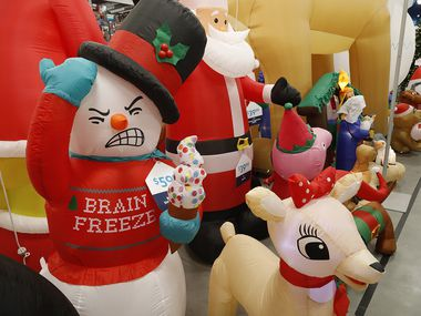 These Christmas yard inflatables at the At Home Store on Hwy. 121 in Plano are among the holiday merchandise that's been moved in as Halloween merchandise is sold out.