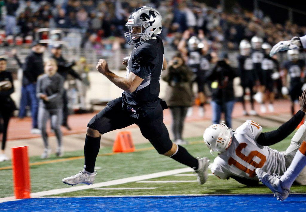 Martin quarterback Zach Mundell (6) carries the ball around the end for a second quarter touchdown against Bowie at Maverick Stadium in Arlington, Texas, Thursday, November 7, 2019. (Tom Fox/The Dallas Morning News)