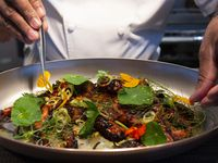 Chef Junior Borges puts the final touches on the grilled octopus at Meridian restaurant, in The Village area of Dallas, Texas on Tuesday, May 25, 2021.