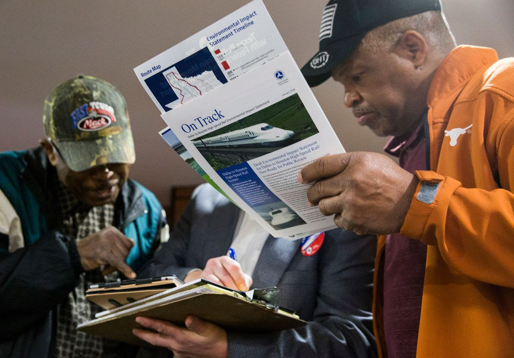 Sam Ramsire, left, and Rickey White, right, talk to Juan R. Zuniga of Contract Land Staff, during an open house for people to view plans and talk to company and corporate officials about a $15 billion Dallas to Houston high-speed rail line on Monday at Wilmer-Hutchins High School in Dallas. (Ashley Landis/The Dallas Morning News)