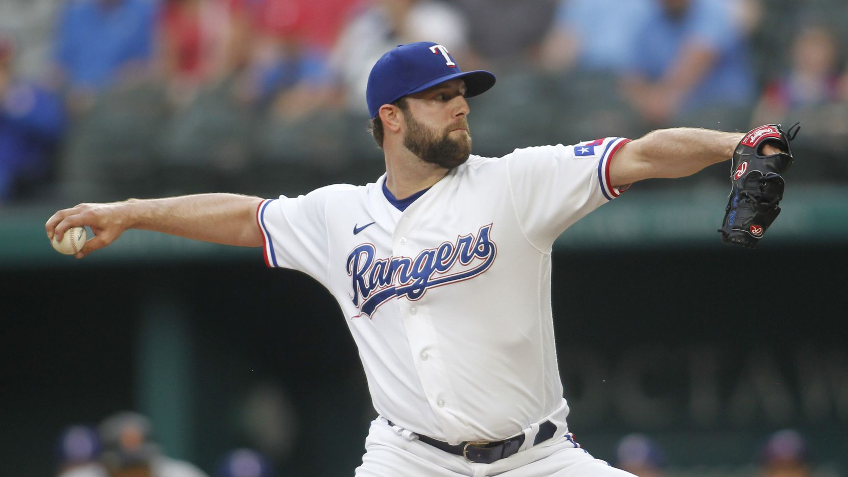 Texas Rangers pitcher Jordan Lyles (24) delivers a pitch during the top of the first inning of their game against the San Francisco Giants. The two teams played their MLB game at Globe Life Field in Arlington on June 8, 2021.